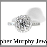 A halo of diamonds was added to the engagement ring, followed by a custom made Double Wedding Ring